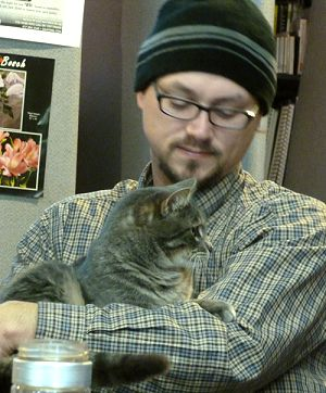 Joshua Shirley, CFO of FundRaiser with Smudge the office cat